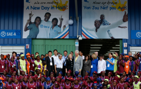 Haiti industrial park opening Caracol Former U.S. President Bill Clinton and U.S. Secretary of State Hillary Clinton pose with workers at the grand opening ceremony of the new Caracol Industrial Park in Caracol, Haiti, on October 22, 2012. (Larry Downing/Reuters)