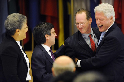 Partners In Health's Farmer and former US President Clinton laugh during conference in Washington