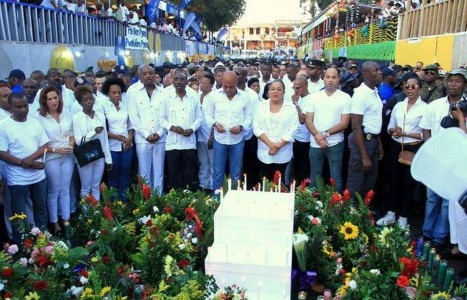 A new, more African public face for the dictatorship leveraging the opportunity of the carnival tragedy. Was the massive, all-white vigil on the same day as the carnival deaths all ceremony, little substance? February 17, 2015. Photo Source: AP